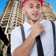 Businessman in front of construction — Stock Photo