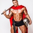Stock Photo: Huge warrior with sword, helmet and mantle