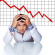 Sad businessman in front of graphic — Stock Photo