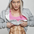 Fit blondie is demonstrating her perfect abs — Stock Photo #24458541