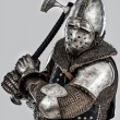 Stock Photo: Armored knight is ready to attack