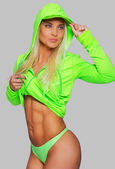 Fit blondie in bright green clothing — Stock Photo