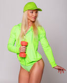 Elegant blondie in sportswear with dumbbell — Stock Photo