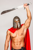 Brave warrior raised his weapon up — Stock Photo