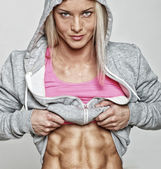 Fit blondie is demonstrating her perfect abs — Stock Photo