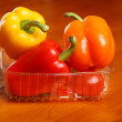 Stock Photo: Vegetables in plastic box on the table