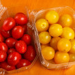 Stock Photo: Red and yellow cherry tomatoes in plastic containers