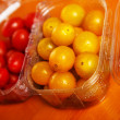Stock Photo: Yellow cherry tomatoes in plastic container