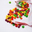 Openned pack which is full of skittles — Stock Photo #34291347