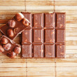 Tasty milk chocolate with nuts — Stock Photo