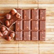 Stock Photo: Tasty milk chocolate with nuts
