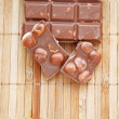 Stock Photo: Some pieces of tasty milk chocolate