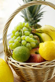 Fruits in wicker basket — Stock Photo