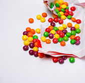 Full of skittles openned pack — Stock Photo