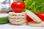 Fresh corn crackers and vegetables — Stock Photo