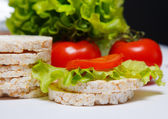 Tasty and appetizing sandwich with tomatoe and salad — Stock Photo