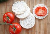 Fresh tomatoes and corn crackers — Stock Photo