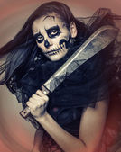 Sinister girl with a skull makeup — Stock Photo