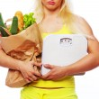 Blonde with paper eco bag and scales — Stock Photo