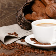 Stock Photo: Cup of coffee surronded by rye bread and coffee beans