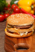 Close-up of a Big Mac on a wooden cutting board — Stock Photo