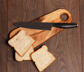 Three pieces of bread and a knife — Stock Photo