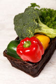 Wicker basket with broccoli, parsley and bell peppers — Stock Photo