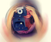 Girl and  vintage camera — Foto Stock