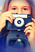Girl and  vintage camera — Stock Photo