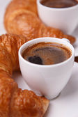 Two cups of coffee and two croissants — Stock Photo