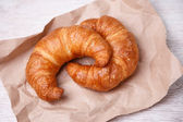 Two croissants on eco paper — Stock Photo