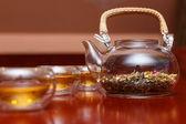 Herbal tea in a transparent teapot — Stock Photo
