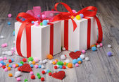 Two gift boxes and woolen pom poms on the floor — ストック写真