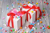 Two gift boxes and woolen beads on the floor — Stockfoto
