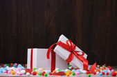 An open gift box and felt balls on a wooden backround — Stockfoto