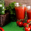 Basket with green veggies and two glasses of juice — Stock Photo #40020227