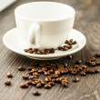 Neat white cup and coffee beans — Stock Photo #40020373