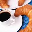 A cup of morning coffee with two croissants — Stock Photo