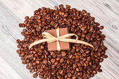 Chocolate with a bow on a pile of coffee beans — Stock Photo