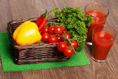 Basket with veggies and tomato juice — Stock Photo