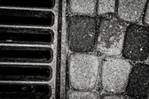 Drainage well closeup in black and white — Stock Photo
