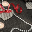 Stock Photo: Tealights and pearl beads in romantic setting