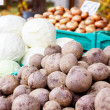 Stock Photo: Potatos and cabbages in market crates