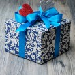 Valentine surprise gift with blue ribbon — Stock Photo