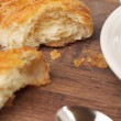 Foto Stock: Two pieces of flaky croissant