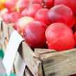 Foto de Stock  : Wooden crate with market apples