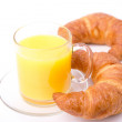 Two croissants on a plate and a cup of juice — Stock Photo #40624925