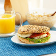 Stock Photo: Sesame and poppyseed bun with orange juice and cereal