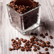 Square tank with coffee beans and chocolate — Stock Photo #40625099