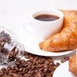 Stock Photo: White cup of coffee and croissants